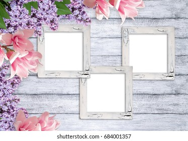Three retro empty photo frames with magnolia and lilacs flowers on background of shabby wooden planks in rustic style
