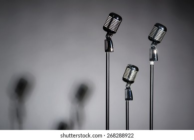 Three retro microphones with space for text