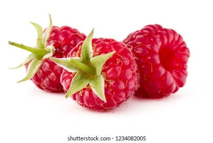 three ripe raspberries isolated on white background close up