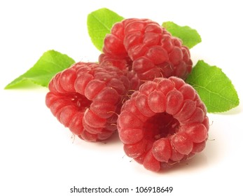 Three ripe raspberries on white isolated background