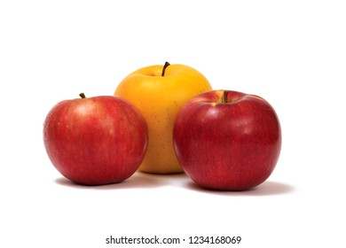 Three ripe red and yellow apples on a white isolated background.