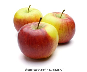 Three ripe red yellow green apples. Fruits at different distances fully sharp (with a large depth of field) isolated on white background with shadows. Clipping path included.