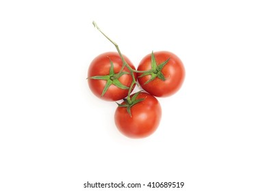 Three ripe tomatoes on a white background
