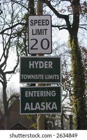 three road signs on a pole - hyder, alaska