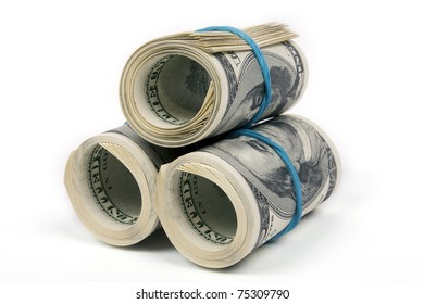 Three rolls from dollars on white background