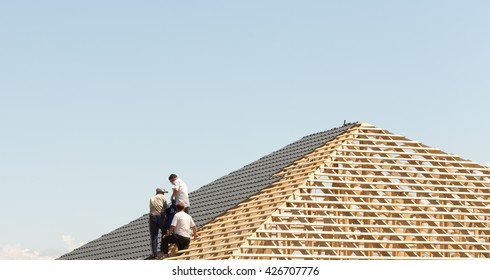 three roofers do roof metal tile