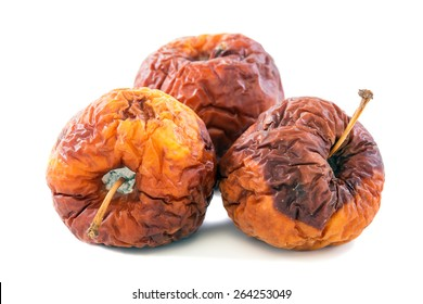 Three rotten apples on a white background.