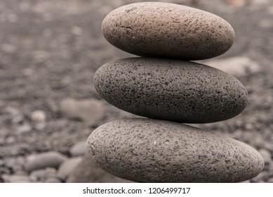 Three round rocks piled up. Taken in Djupalonssandur, Iceland.