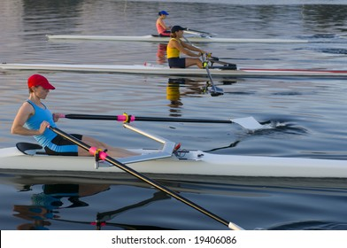 three rowers competing.