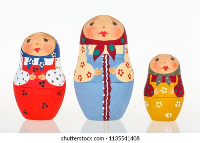 Three Russian dolls babushka matryoshka isolated on white background