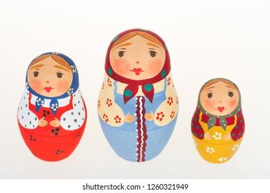 Three Russian dolls babushka matryoshka isolated on white background