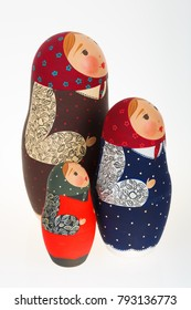 Three Russian dolls babushka matryoshka looking in one direction