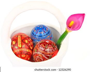 three Russian tradition easter eggs and violet orchid in white porcelain basket