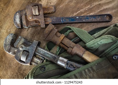Three rusted and worn pipe wrenches