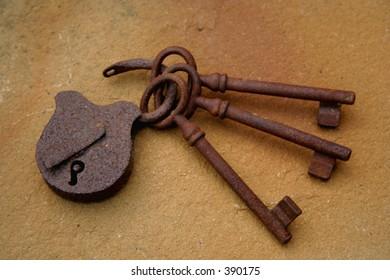 three rusty keys and lock