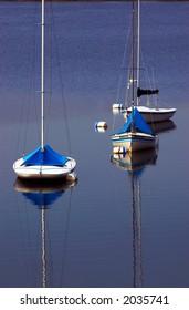 Three sail boats docked on Lake Calhoun. More with keyword group18