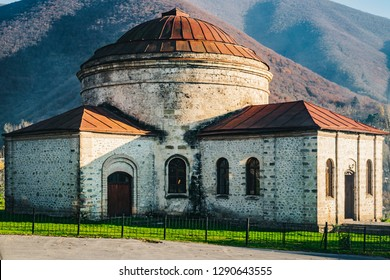 Three Saints Church and mountains on a sunny autumn day. 2018, Sheki, Azerbaijan.