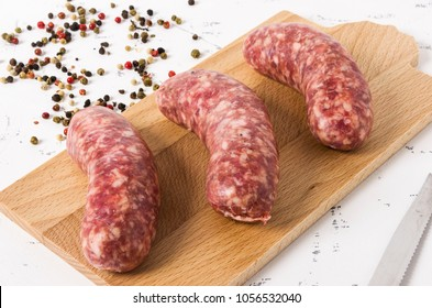 Three sausages on white background.