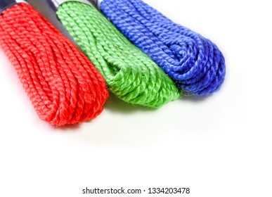 Three sawing silk threads in colors rgb with white copy space for text.