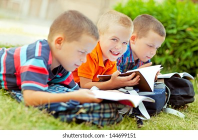 Three schoolboys studying together after school.