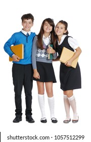 Three schoolchildren with manuals in hands wearing formal outfit