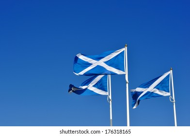 Three Scotland or Scottish flags, known as the saltire or St Andrew's cross.