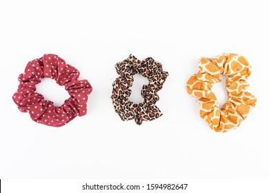 Three scrunchies on white background