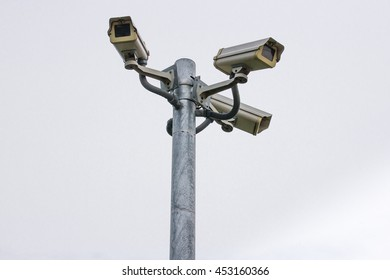 Three security cameras against on white back ground.