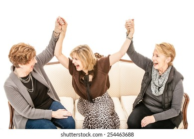 Three senior women celebrating