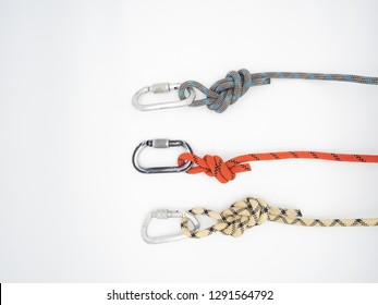 Three separate ropes with carabiners isolated on white - red, white and blue. Figure eight knot with carabiner. Looks like histogram or linear diagram with equals columns or rows.