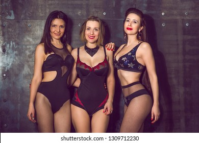 Three sexy women in lingerie. Underwear clothes. Middle aged american or european ladies sensual concept