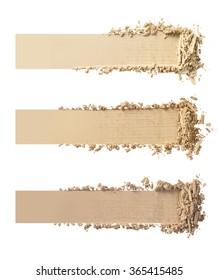 Three shades of makeup powder on white background.