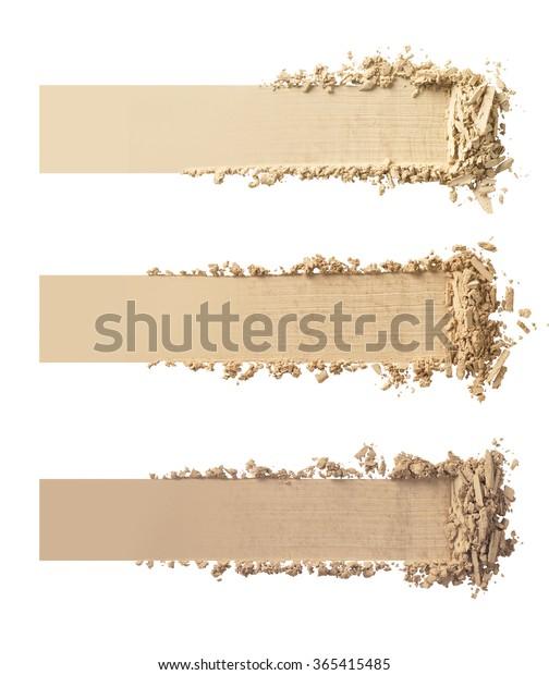 白い背景に化粧粉の3つのシェード。