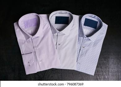 Three shirts for men on black background
