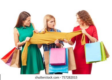 Three shopaholic women fighting over sweater on Black Friday