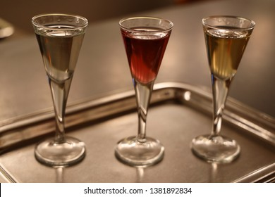 Three shots of Aquavit. Akvavit or aquavit is a distilled spirit that is principally produced in Scandinavia, where it has been produced since the 15th century.