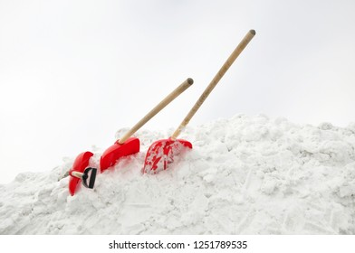 Three shovels in a snowdrift.