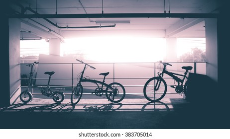 Three silhouette bikes in Pantone 2016. White copyspace for text in the middle.