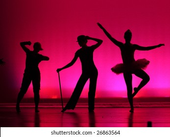 Three silhouetted dancers