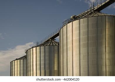 three silos against a blue sky