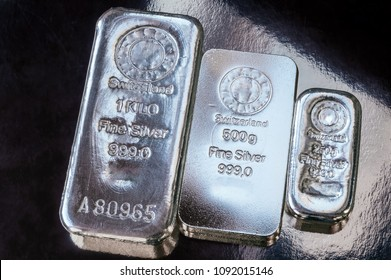 Three silver bars of different weight. The surface of cast silver bullion.