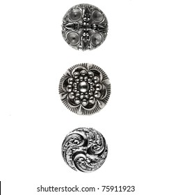 Three silver buttons placed on white background