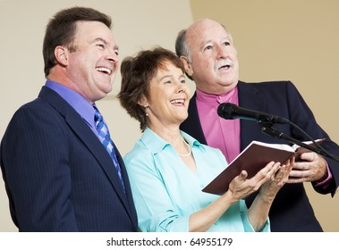 Three singers performing from the church hymnal.
