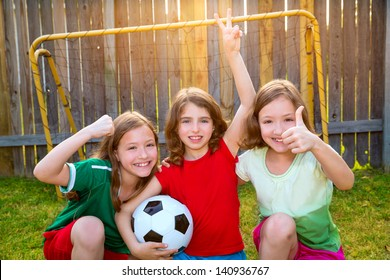 three sister girls friends soccer football winner players on the backyard