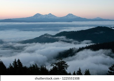 Three Sisters and marine layer at twilight, from Carpenter Mountain fire lookout, H.J. Andrews Experimental Forest, Willamette National Forest, Oregon, USA