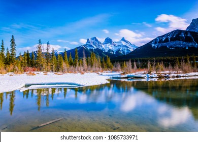 Three Sisters Mountain at Canmore, Alberta, Canada. This photo was taken during the transition between winter and snow season.
