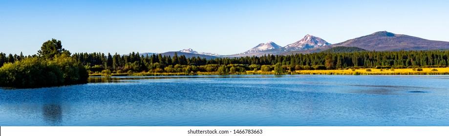 The three sisters  mountains and lake Phalarope in a panorarama imasge near Sisters, Oregon