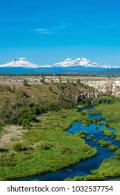 Three sisters Mountains rising above Deschutes River in Oregon