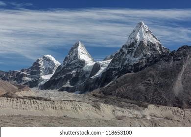 Three sisters Nirekha (6169 m), Kangchung (6062 m), and Chola (6069 m) in the area of Cho Oyu - Gokyo region, Nepal