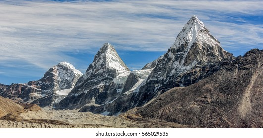 Three sisters Nirekha (6169 m), Kangchung (6062 m), and Chola (6069 m) in the area of Cho Oyu - Gokyo region, Nepal, Himalayas